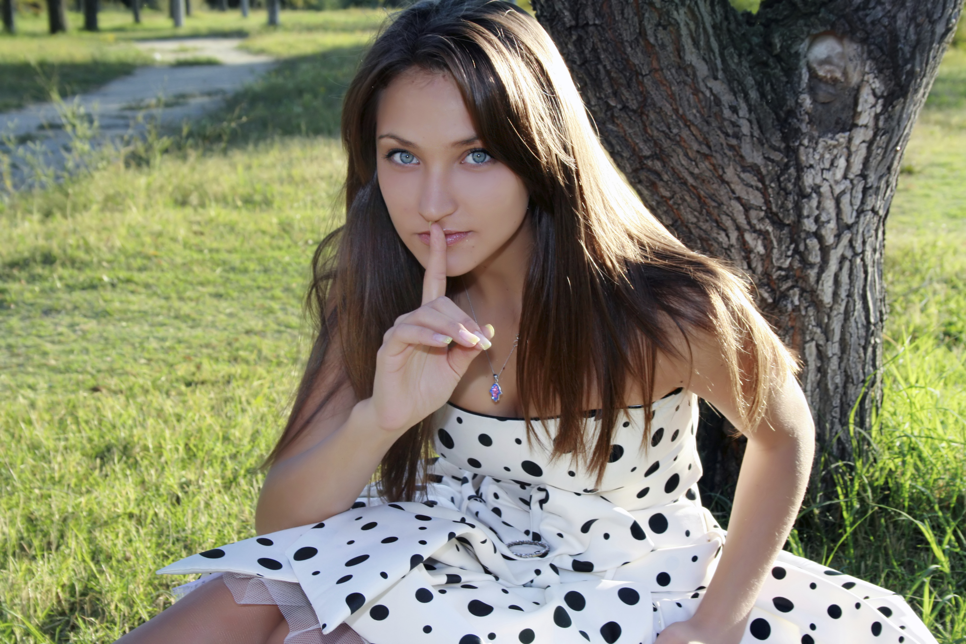 young healthy woman making the silence sign..she has a secret